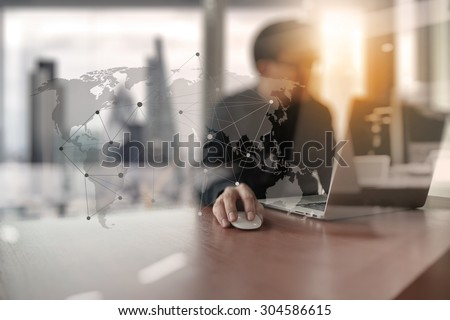 Young creative designer man working at office with computer laptop as concept with social media diagram      - stock photo