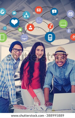 Young creative team having a meeting against college classroom - stock photo