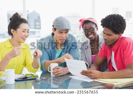 Young creative team having a meeting in creative office - stock photo