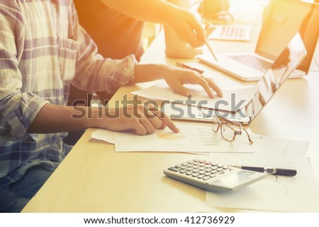 Young creative team working together in casual office - stock photo