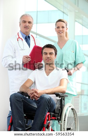 Young cripple and medical team
