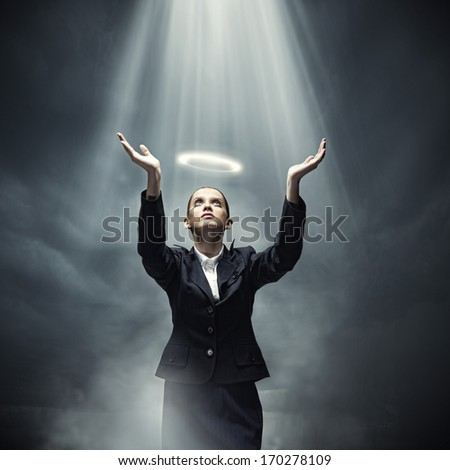 Young crying businesswoman with halo above head - stock photo