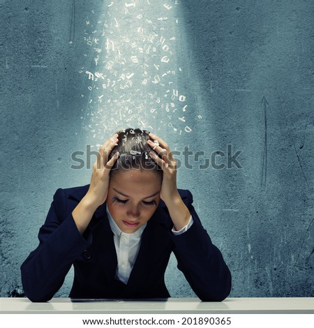 Young crying businesswoman with hands on head