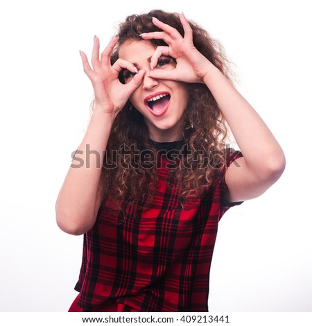 young curly girl doing glasses gesture isolated on white