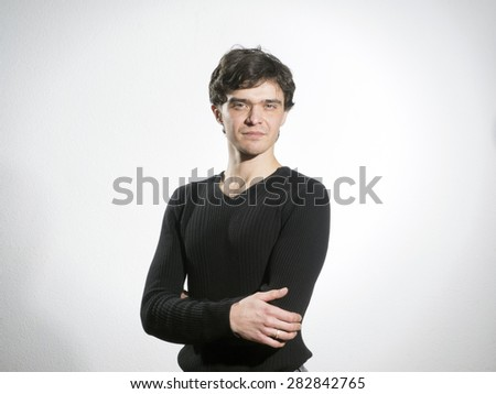 Young curly man in dark jumper  - stock photo