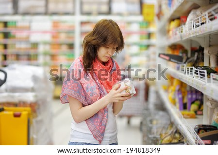 Young customer at groceries store  - stock photo