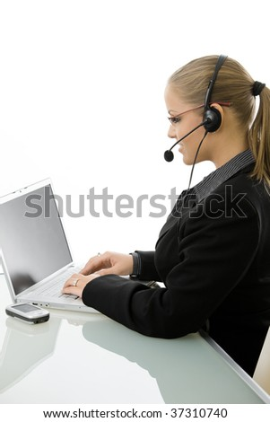 Young customer service operator girl wearing headset, working on laptop computer, side view, isolated on white background. - stock photo