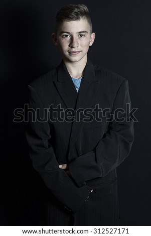 young cute boy in oversize suit