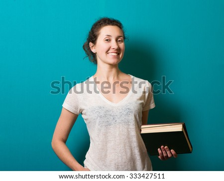 Young cute business woman with a book in her hands - stock photo