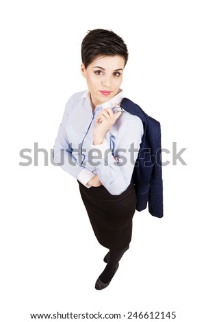Young cute confident business woman looking at camera. High angle view wide lens full body length portrait isolated over white background. - stock photo