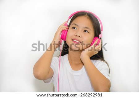 young cute girl asian listening to music   - stock photo