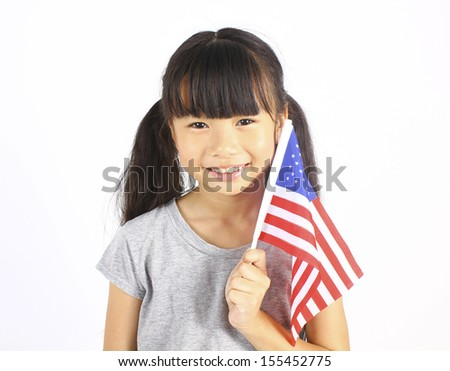 Young cute girl holding an American Flag  - stock photo