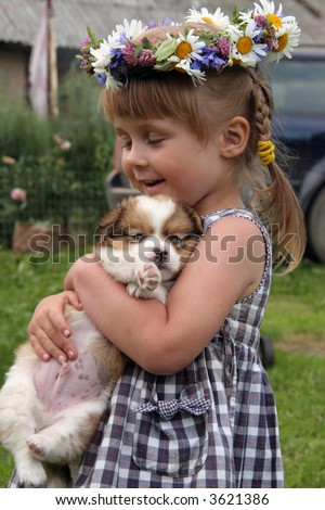 young cute girl in farm with her dog - stock photo