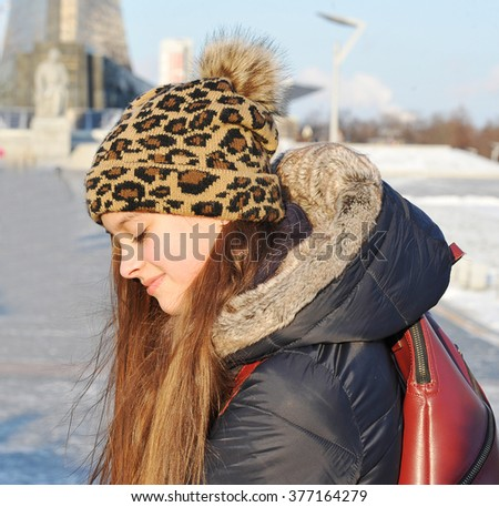 young cute girl in winter clothes - stock photo