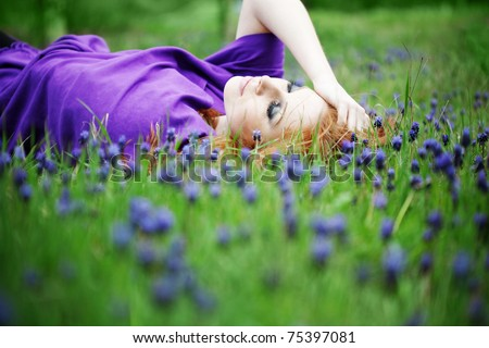 Young cute girl resting in fresh grass - stock photo