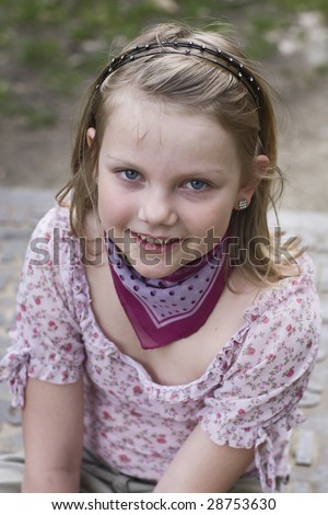 Young cute girl smiling, portrait - stock photo