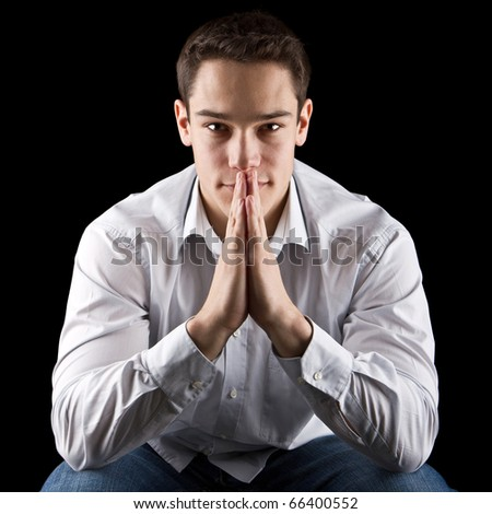Young cute, handsome and thoughtful man with his hands - stock photo
