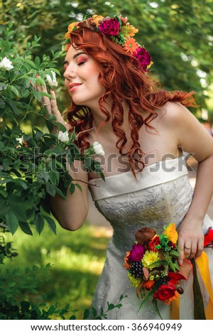 Young cute redhead bride with perfect make up and hair style