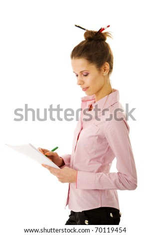 Young cute secretary reading contract isolated on white