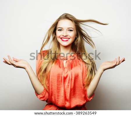 Young cute smiling blond girl - stock photo