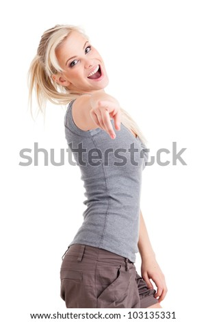 Young cute smiling girl pointing on you isolated on white - stock photo