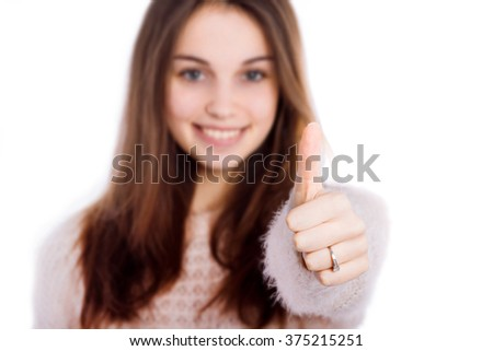 Young cute smiling girl showing OK - stock photo
