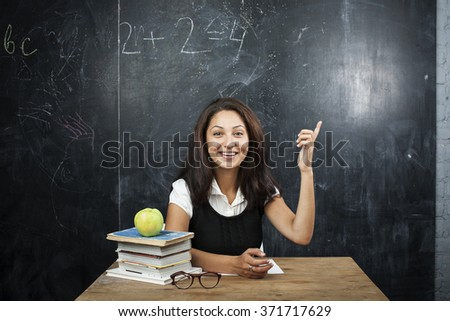 young cute tanned teenage girl happy pointing, thinking, education concept - stock photo
