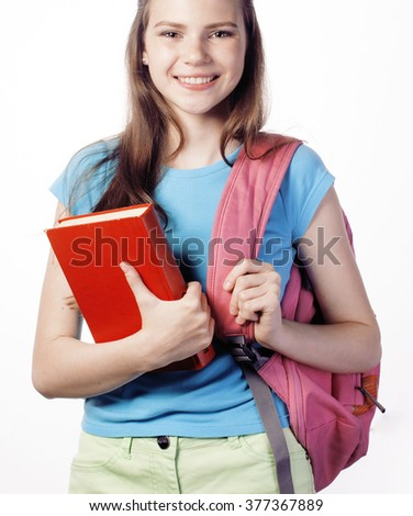 young cute teenage girl posing cheerful against white background with books and backpack close up isolated