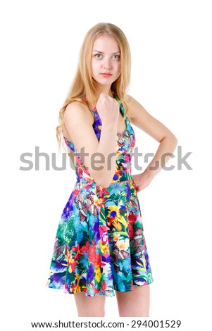Young cute teenager blonde girl showing fist, isolated on white background, positive human emotion, facial expression - stock photo