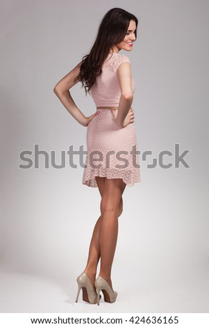 Young cute woman posing in dress - stock photo