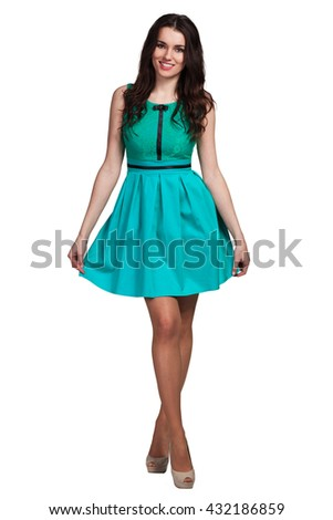Young cute woman posing in dress on white background