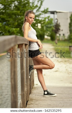 Young cute woman resting after jogging