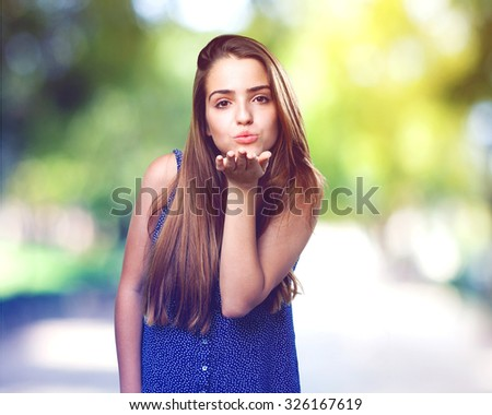 young cute woman sending a kiss