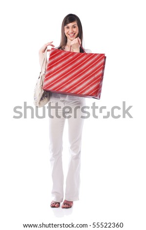Young cute woman standing and holding shopping bags - stock photo
