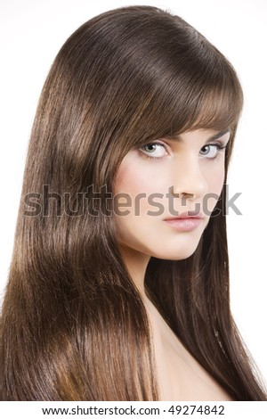 young cute woman with long and smooth black hair isolated on white - stock photo