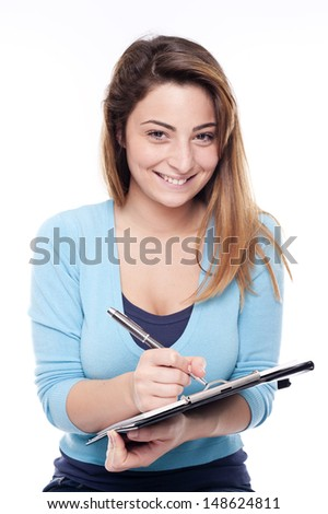 Young cute woman writing on white background