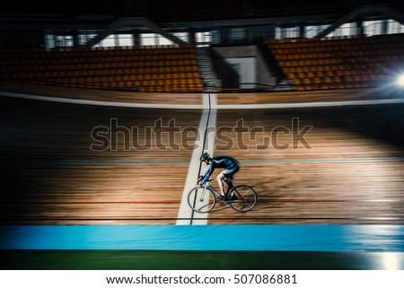 Young cyclist on a velodrome