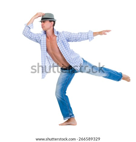 Young dancer jumping against isolated white background