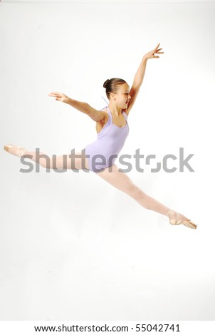 Young Dancer Leaping through the air - stock photo