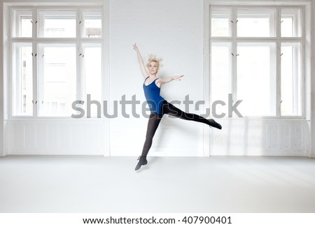 Young dancer practicing in studio. Motion blur. - stock photo