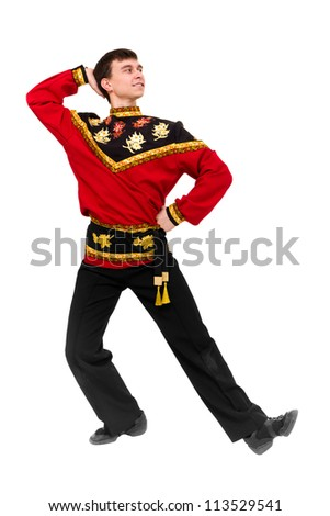 young dancer wearing a folk russian costume dancing against isolated white background - stock photo