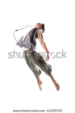 Young dancer wearing headphones and jumping - stock photo