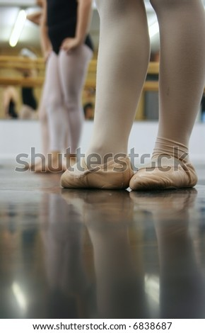 Young dancers are learning - they're all in a line trying to repeat what the instructor has shown them. - stock photo