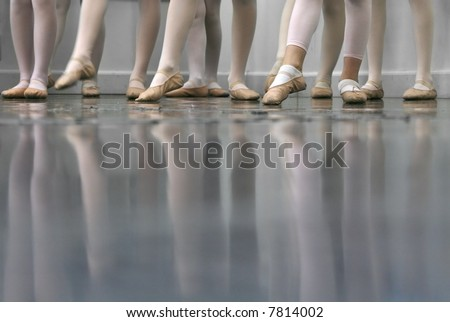 Young dancers... low angle shot of just feet and legs - this view has had the color removed from the floor and wall. - stock photo
