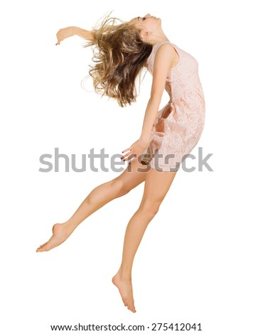 Young dancing girl in dress isolated - stock photo