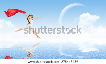 Young dancing girl in dress on water surface - stock photo