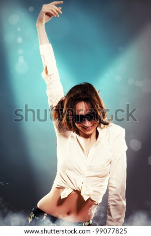 young dancing woman in spotlight