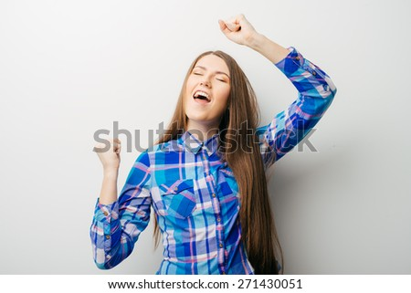 young dancing woman with long hair - stock photo