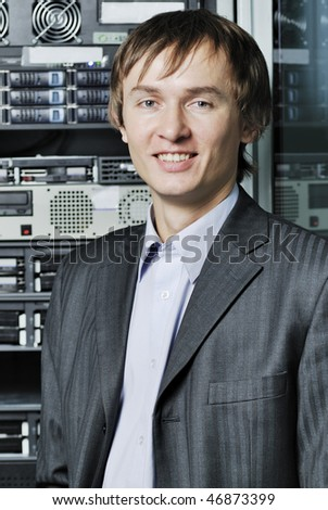 Young data center specialist in front of equipment - stock photo