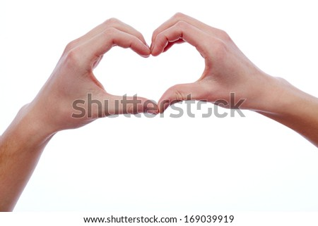 Young dates hands making heart in isolation - stock photo